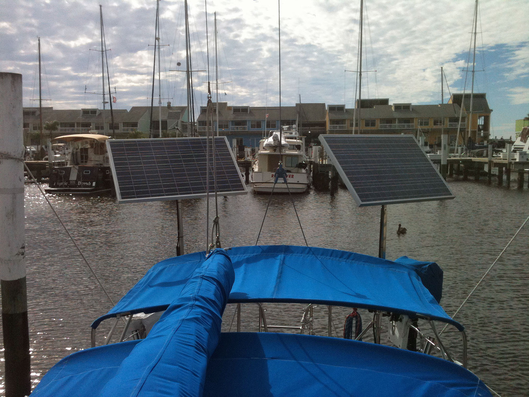 Marine solar panel installations first mate marine inc - Two 90 Watt Top Of Pole Mounted Solar Panels
